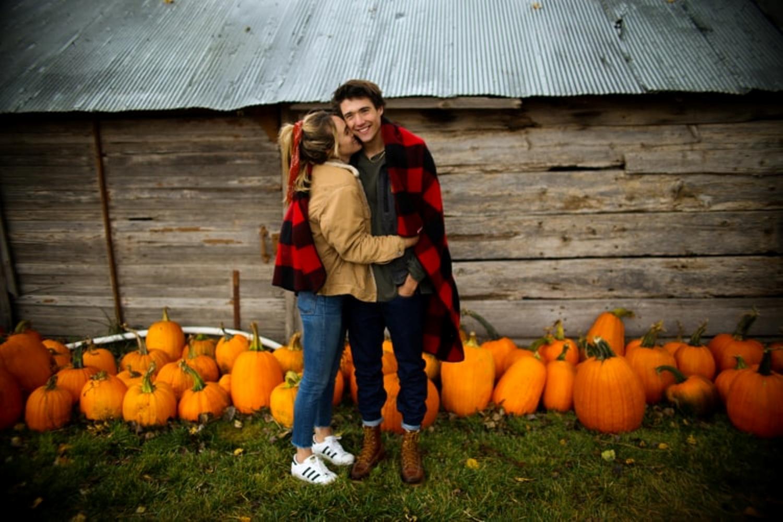 couple in pumpkin patch