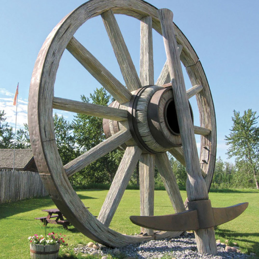 roadside attractions worlds-largest-wagon-wheel-and-pick-axe-768x892